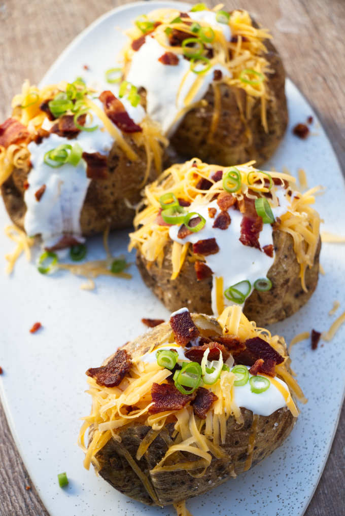 overhead photo of air fryer baked potatoes