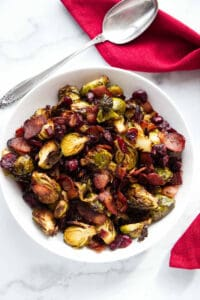 Overhead photo of air fryer Brussels sprouts with a serving spoon