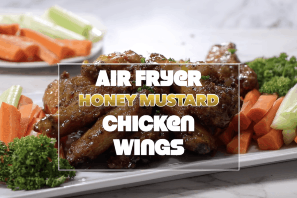 air fryer honey mustard chicken wings recipe cover image with chicken wings coated in honey mustard sauce in pile on a white plate with carrots and celery