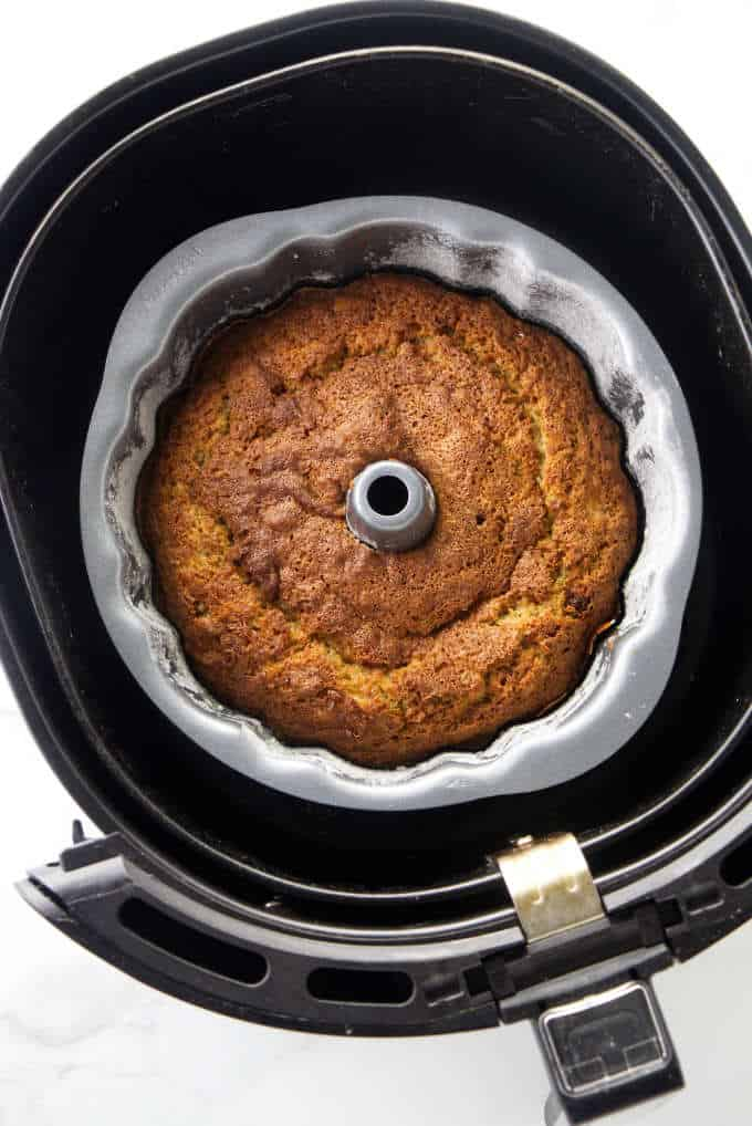 Banana bundt cake in an air fryer basket.