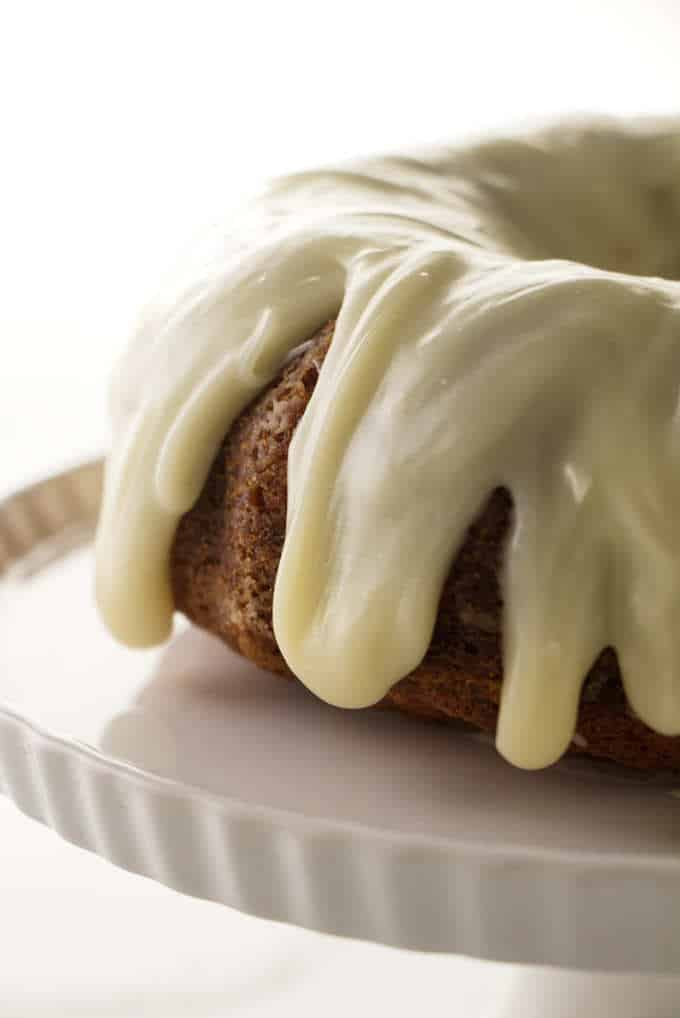 A banana bundt cake with cream cheese icing.