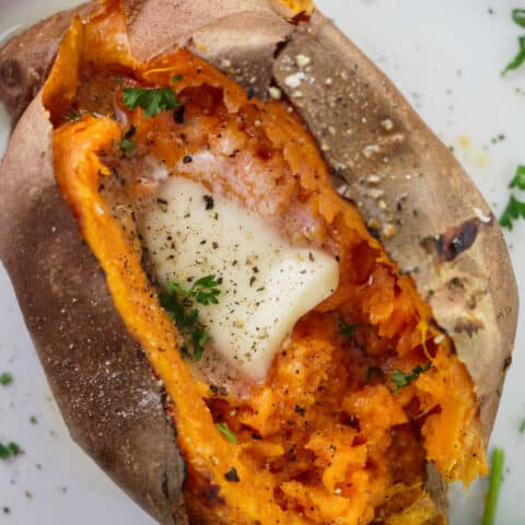 Air fryer baked sweet potato with butter, salt and pepper.