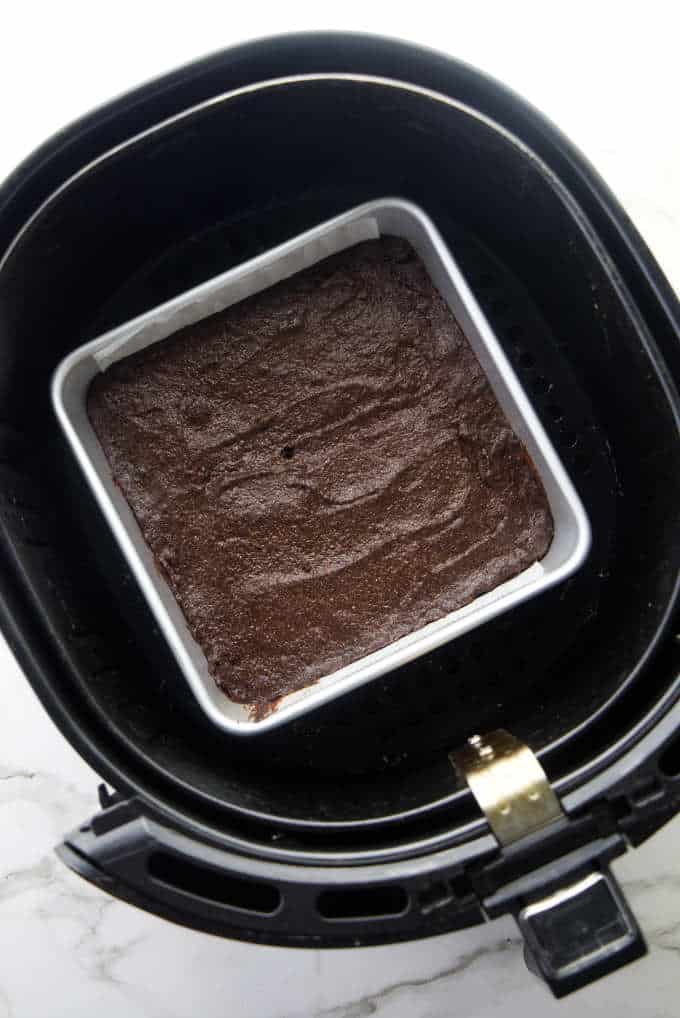 A pan of brownies in an air fryer basket.