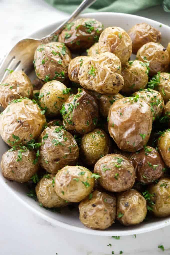Baby potatoes with butter and chopped parsley.