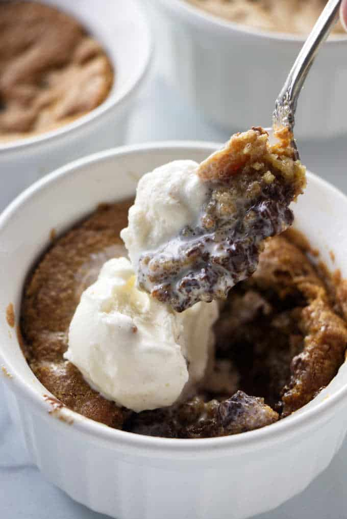 A spoon scooping into a deep dish cookie bowl.