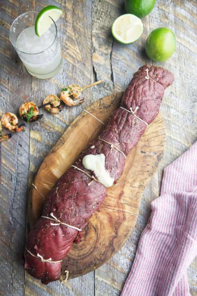 tequila lime shrimp stuffed flank steak with shrimp skewer and margarita