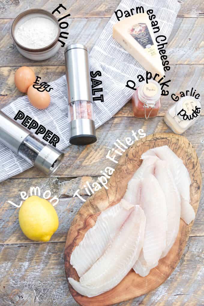 ingredients for tilapia fish tacos: tilapia fillets, lemon, garlic powder, paprika, parmesan cheese, eggs, flour, salt, pepper