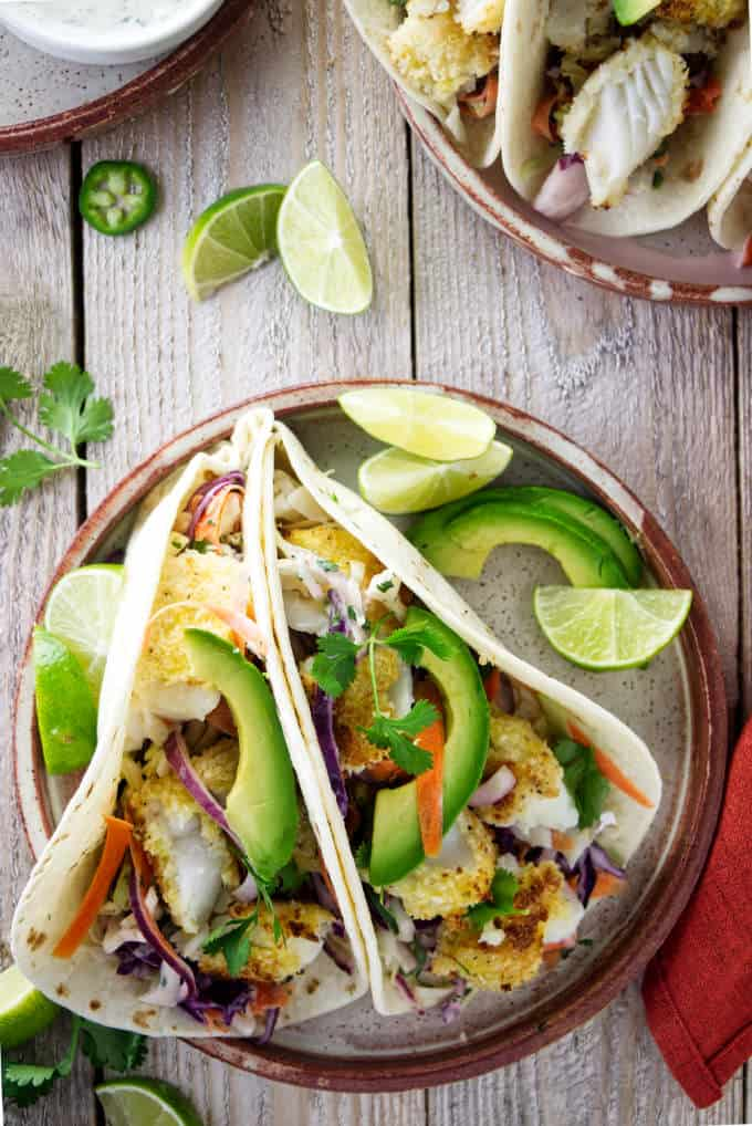 An overhead view of tilapia fish tacos on a plate.