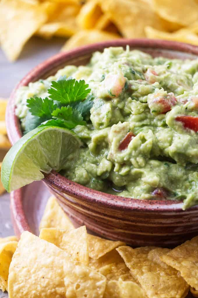 Completed recipe of guacamole with tomatoes and pepperoncini
