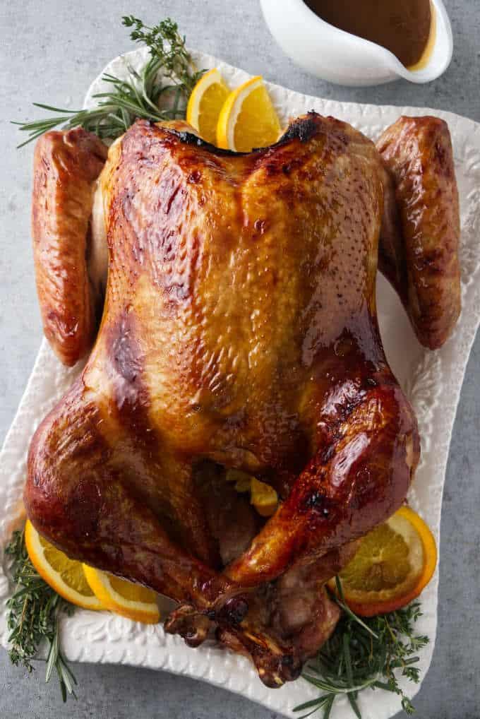 Bourbon brined Traeger turkey with a golden glaze from a brown sugar bourbon glaze.