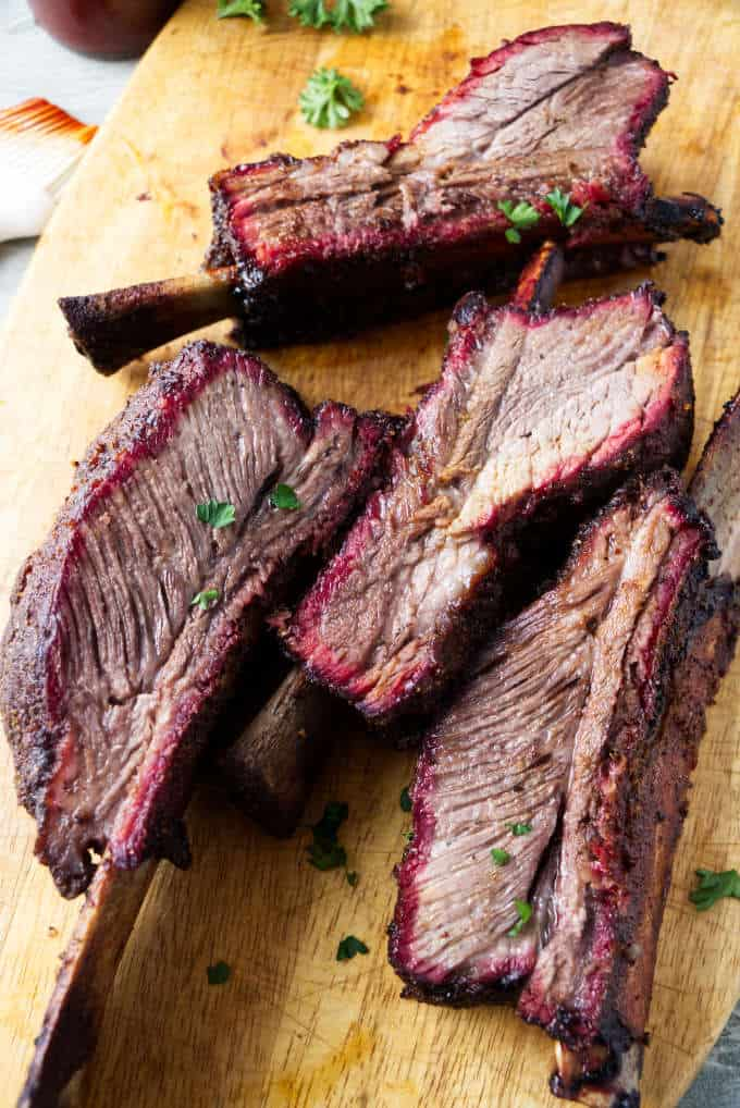 Smoked beef plate short ribs showing the smoke ring after being sliced.