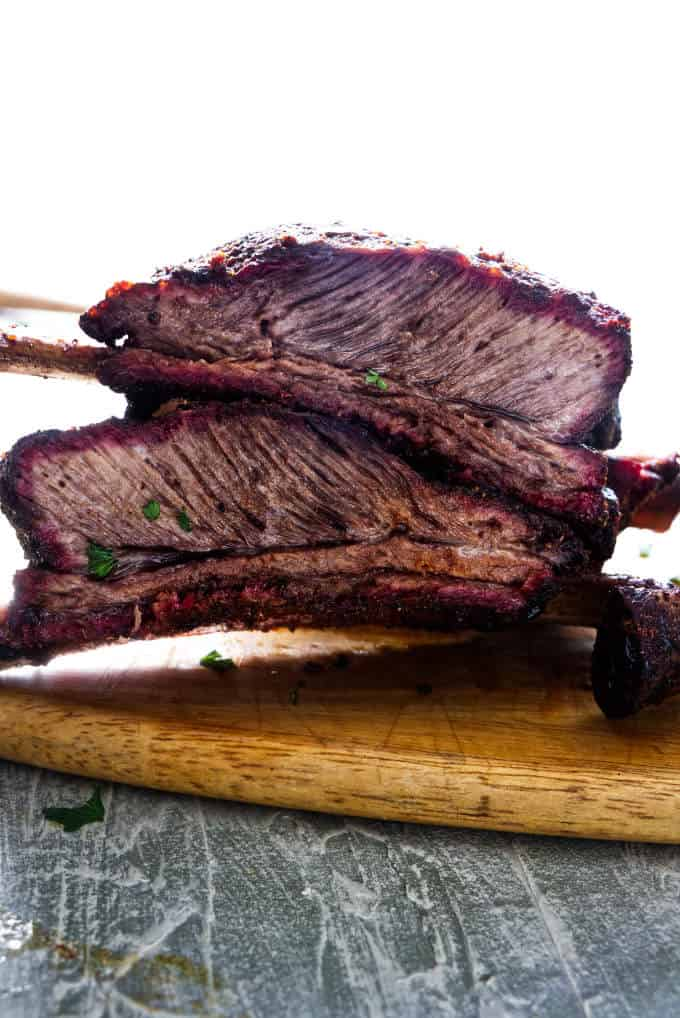 """Two """"dino' beef plate ribs stacked on top of each other."""