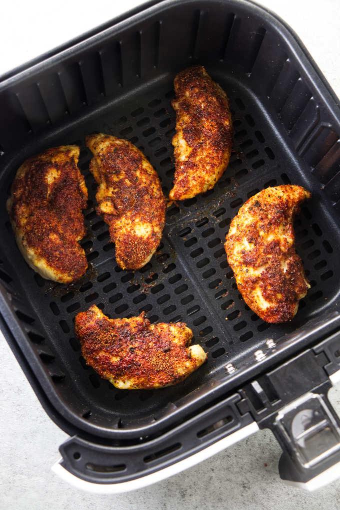 Chicken tenderloins baked in an air fryer.