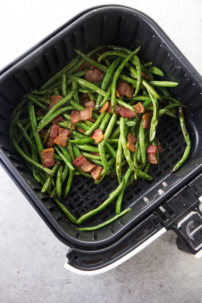 Green beans and bacon in an air fryer.