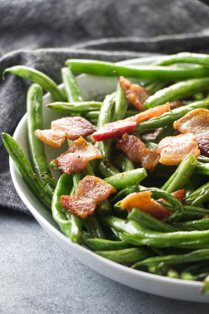 A serving of green beans with bacon.