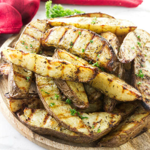A serving platter with grilled potatoes.