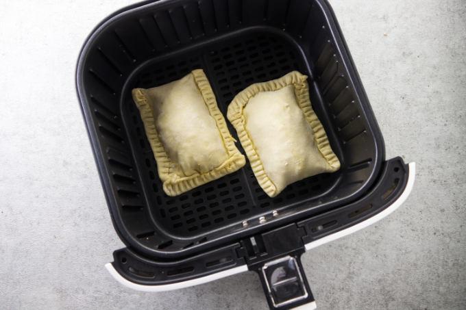 Uncooked breakfast pockets in an air fryer.