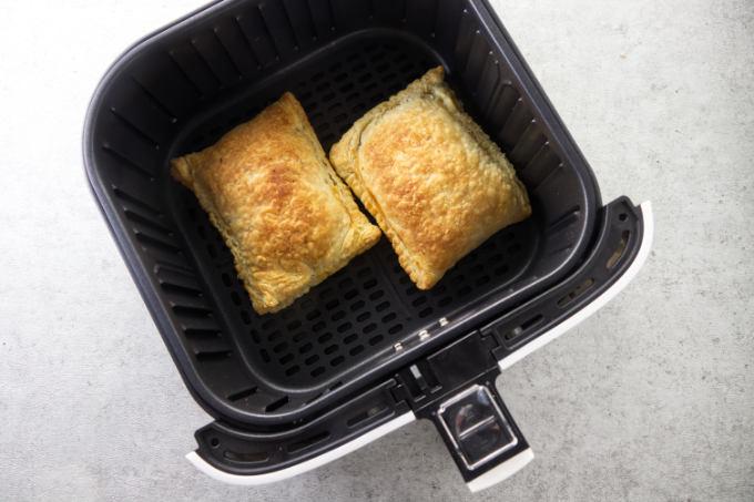 Freshly baked breakfast pockets in an air fryer.