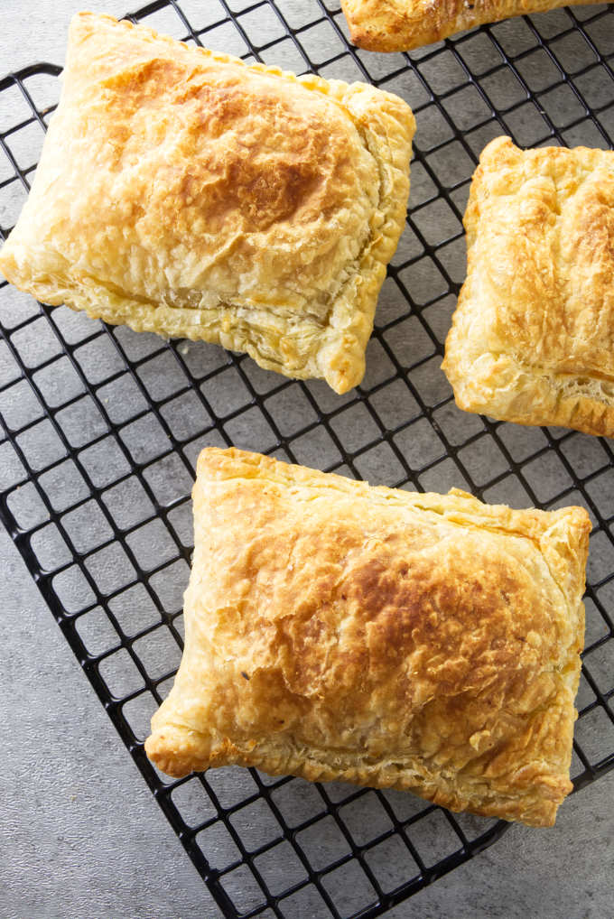 Air fryer breakfast pockets cooling on a wire rack.